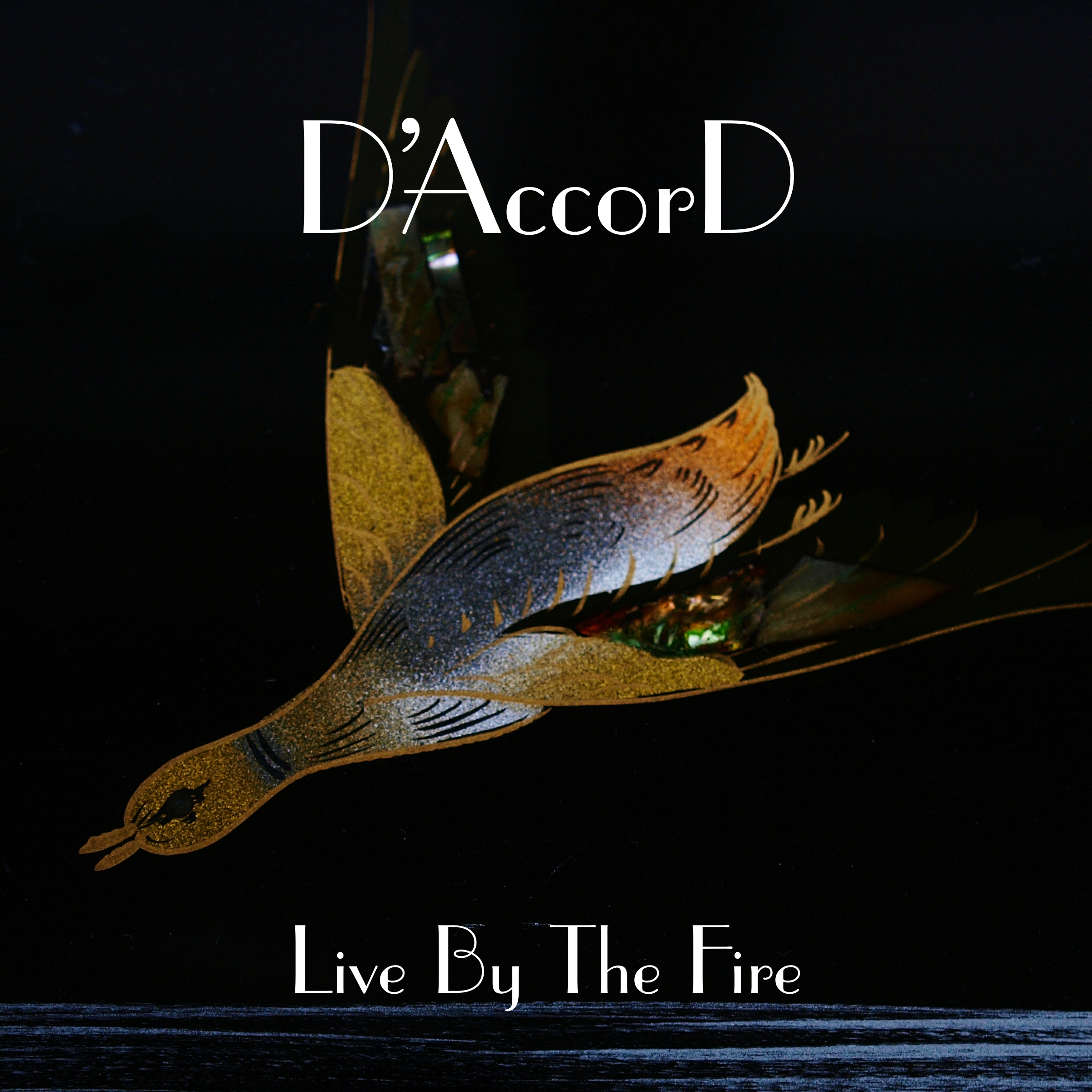 Cover art: D'Accord - Live By The Fire
